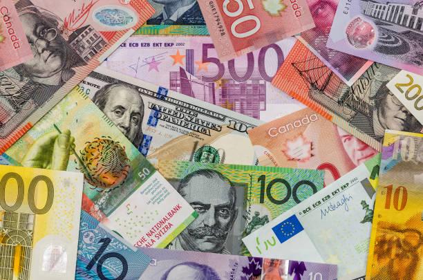 american dollars, european euro, swiss franc, canadian dollar, australian dollar  bills - exchange rate stock pictures, royalty-free photos & images