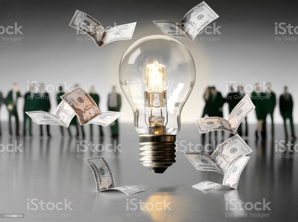 American Dollars Flying Around a Light Bulb with Business People royalty-free stock photo