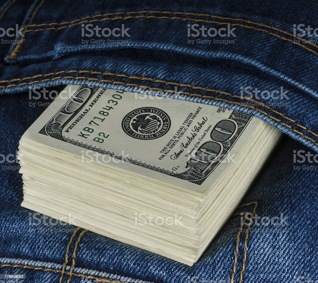American dollars in a jeans pocket royalty-free stock photo