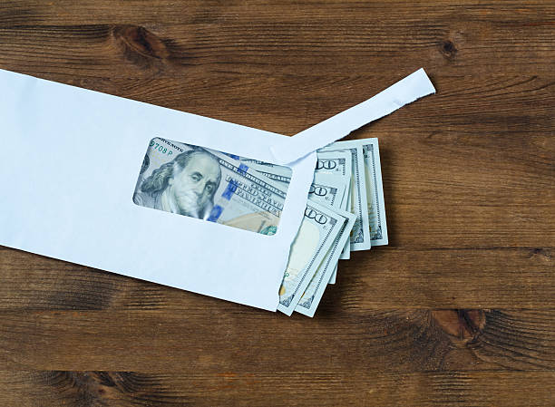 american dollars in  envelope - social security check stock photos and pictures