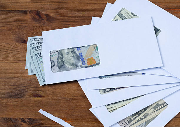 american dollars in the envelopes - social security check stock photos and pictures