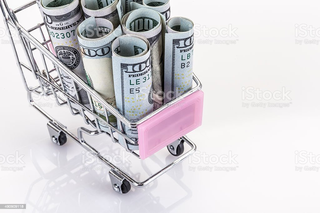 american dollars in trolley stock photo