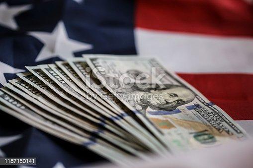 USD American Dollar banknotes on American flag.