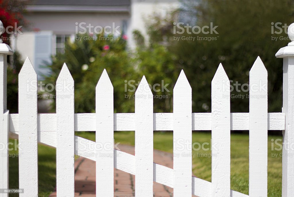 American Dream: Bungalow with White Picket Fence and Garden stock photo