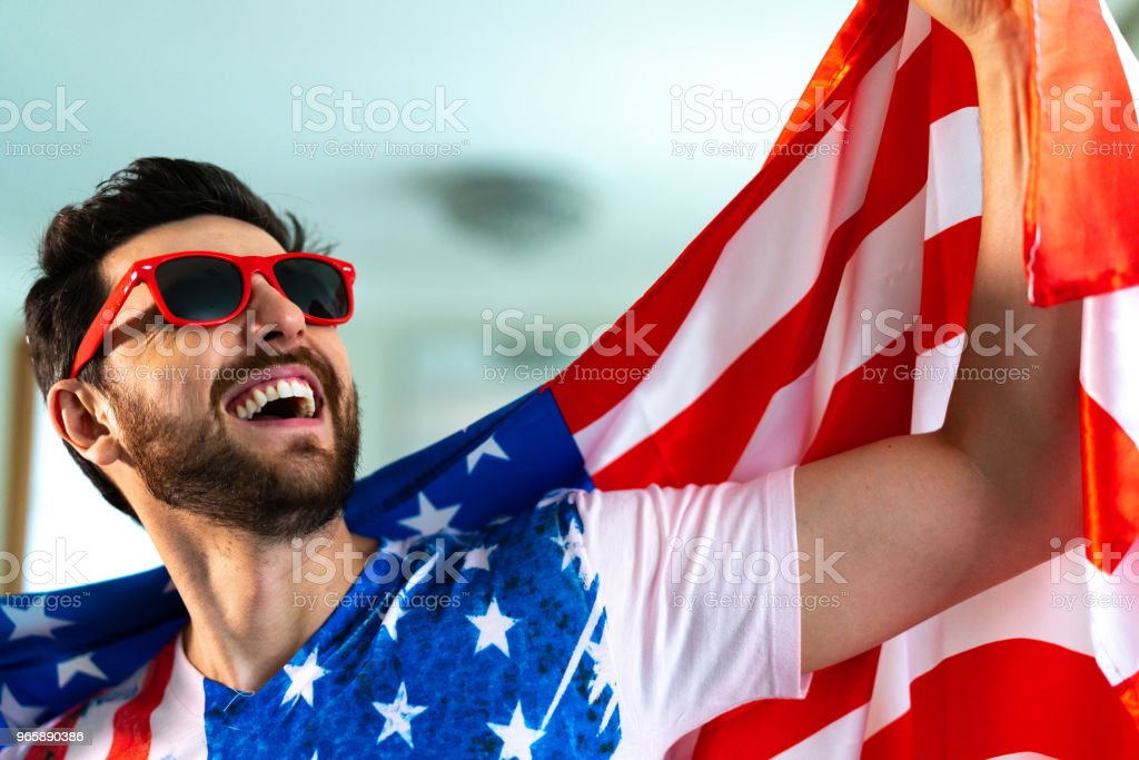 American fan celebrating at home - Royalty-free Adult Stock Photo
