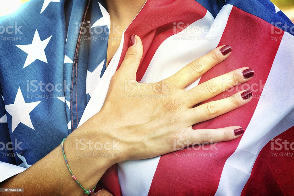 American Fan Putting Hand on Hearth During the National Anthem stock photo