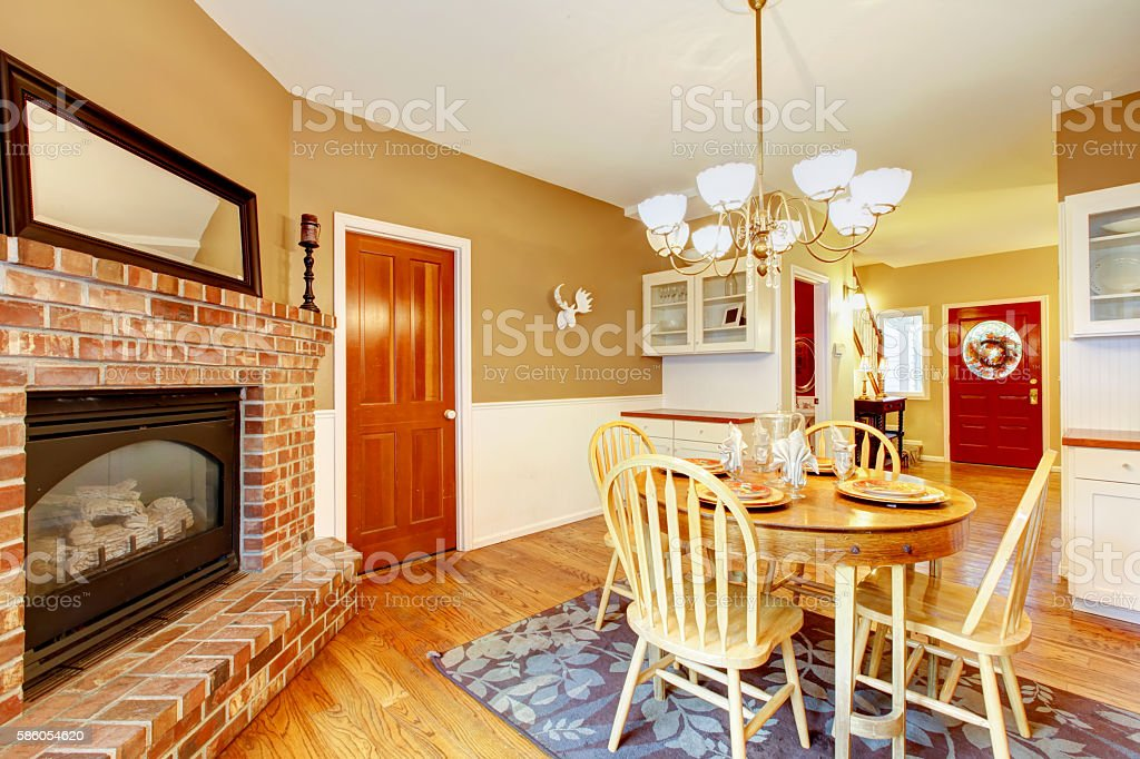 American Farm House Breakfast Dining Room Area With Brick Fireplace
