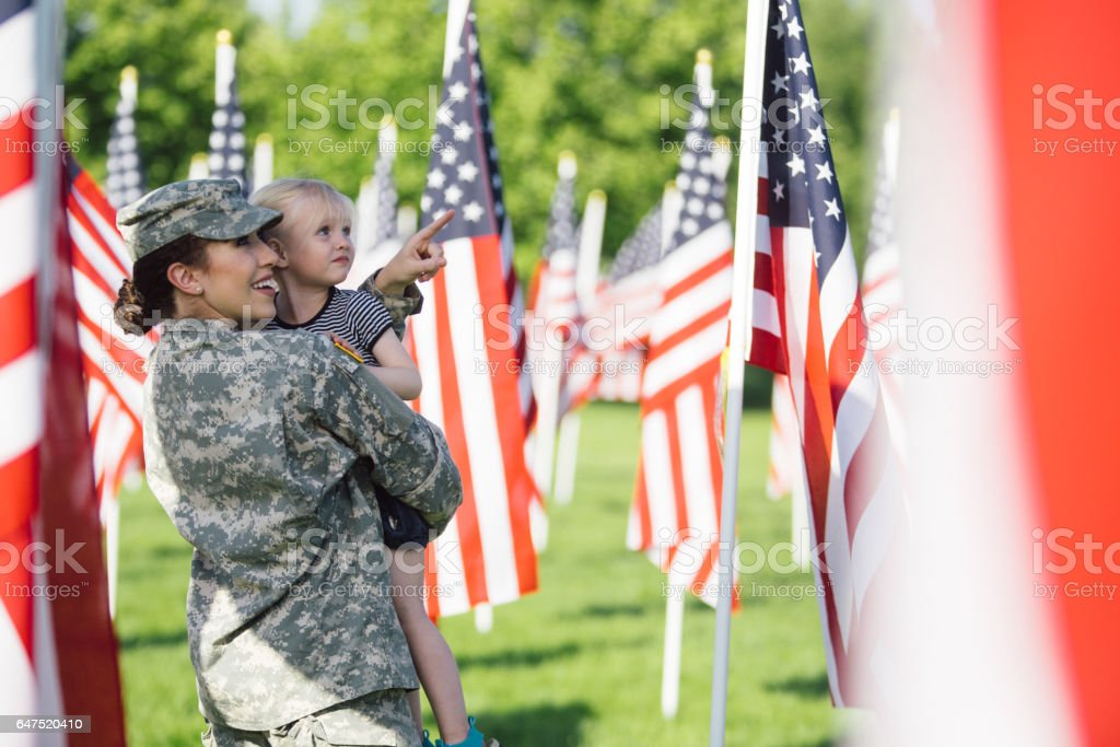 American female soldier with 3 year old girl stock photo