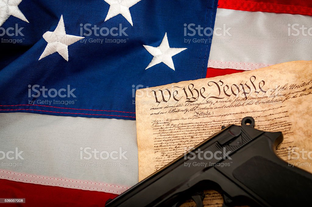 American Flag, a handgun and the US constitution stock photo