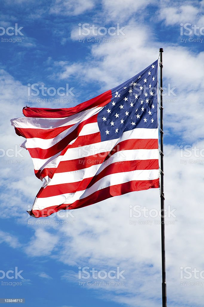 American Flag against a beautiful blue sky royalty-free stock photo