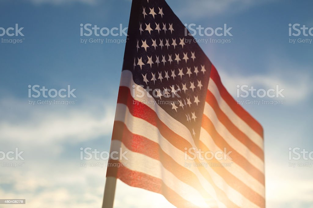 American Flag Against Blue Sky royalty-free stock photo
