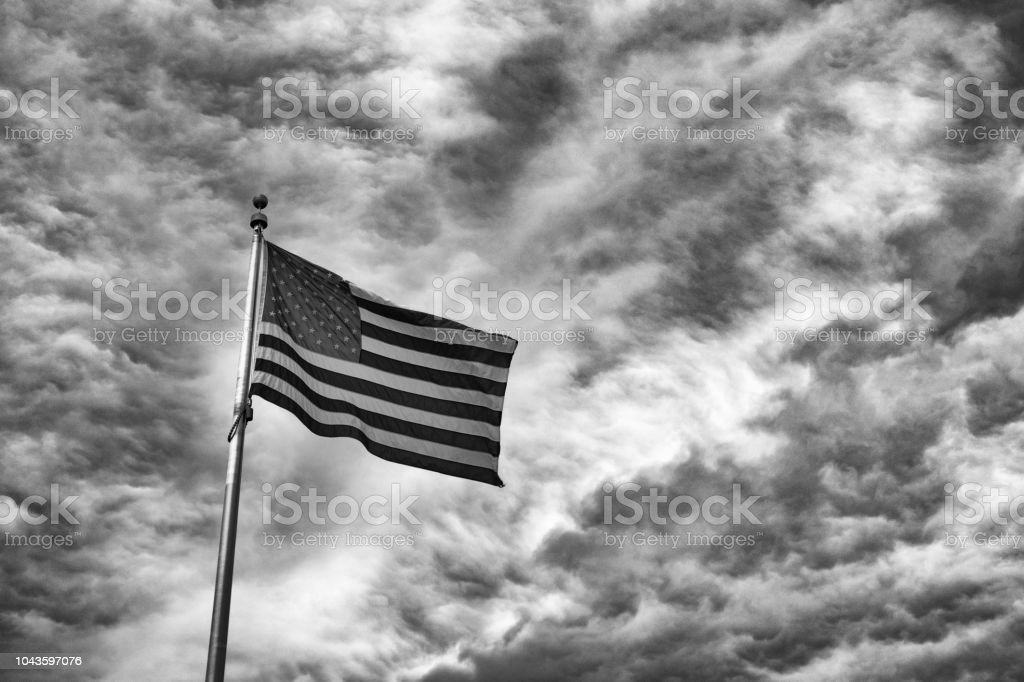 American Flag against Dramatic sky in Black and White