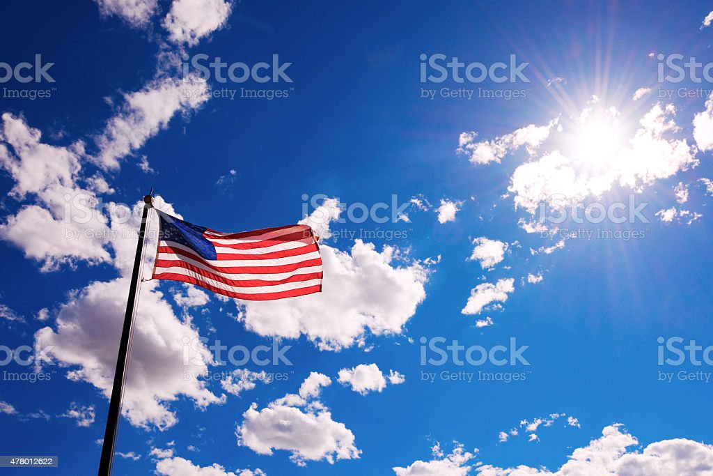 American flag against sky stock photo