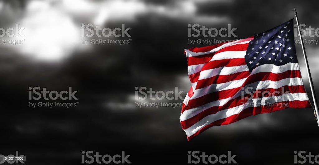 American Flag Against Stormy Background - foto de acervo