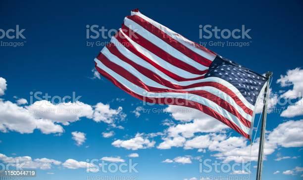 American flag against the sky at dusk picture id1150044719?b=1&k=6&m=1150044719&s=612x612&h=hwzex55h4y4tnn3l5paqz2xjbqpcydqgxgavivqln44=
