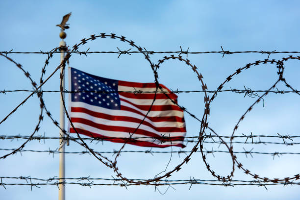 American flag and barbed wire, USA border American flag and barbed wire, USA border department of homeland security stock pictures, royalty-free photos & images