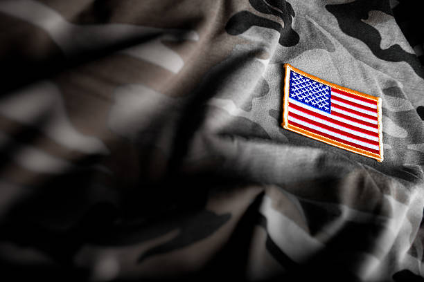 american flag and camoflage (military series) - veterans day 個照片及圖片檔