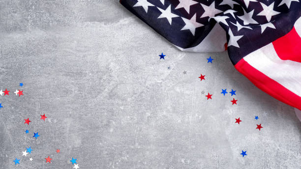 US American flag and confetti star on concrete stone background with copy space. Banner template for Presidents day, USA Memorial day, Veterans day, Labor day, or 4th of July celebration.