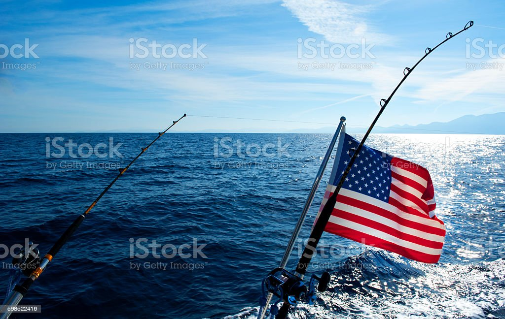 American flag and Deep Sea Fishing rod stock photo