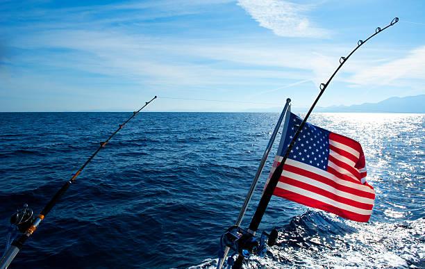 American flag and Deep Sea Fishing rod stock photo