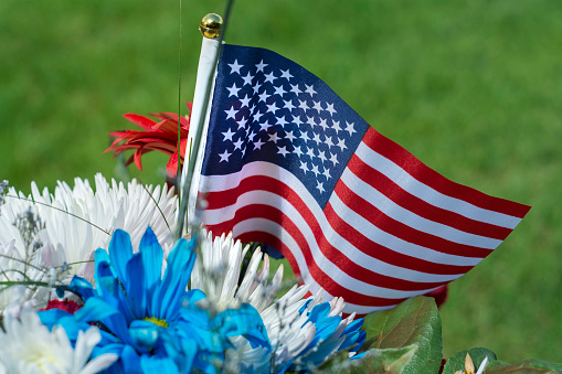 american flag and flowers for memorial day