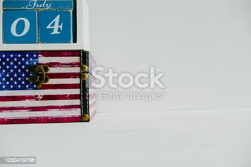 537898300istockphoto American flag and fourth of july calendar date 1030419798