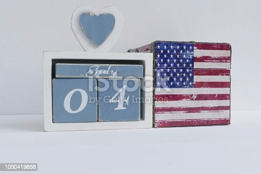 537898300istockphoto American flag and fourth of july calendar date 1030419858