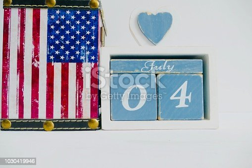 537898300istockphoto American flag and fourth of july calendar date 1030419946