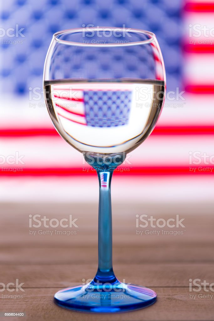 American flag and glass of white wine, party concept stock photo