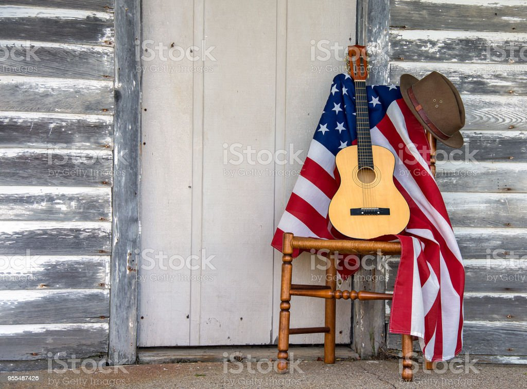 American flag and guitar on chair stock photo