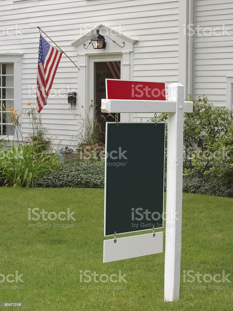 American Flag and Real Estate Sign stock photo