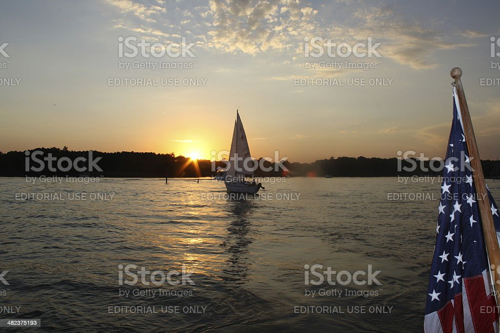 American Flag and Sailing into the Sunset stock photo