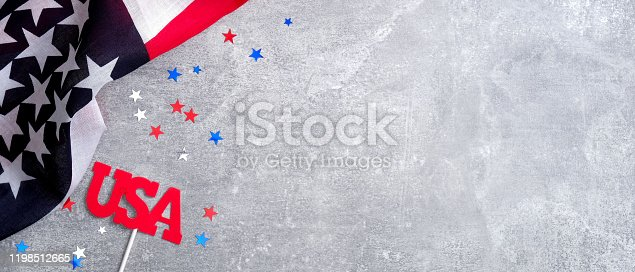 971061452 istock photo American flag and sign USA on concrete stone background with copy space. Banner template for USA Memorial day, Presidents day, Veterans day, Labor day, or 4th of July celebration. 1198512665