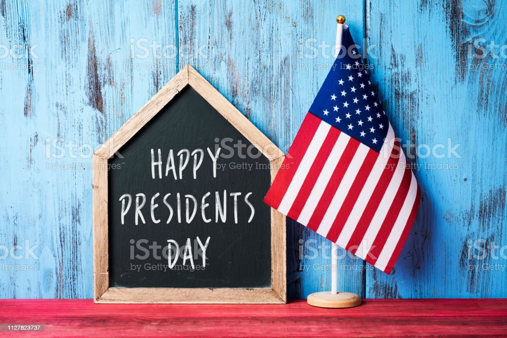 american flag and text happy presidents day stock photo