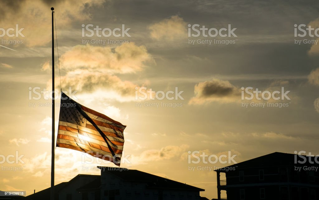 American Flag at Half Mast after another School Shooting A Scary future for America stock photo
