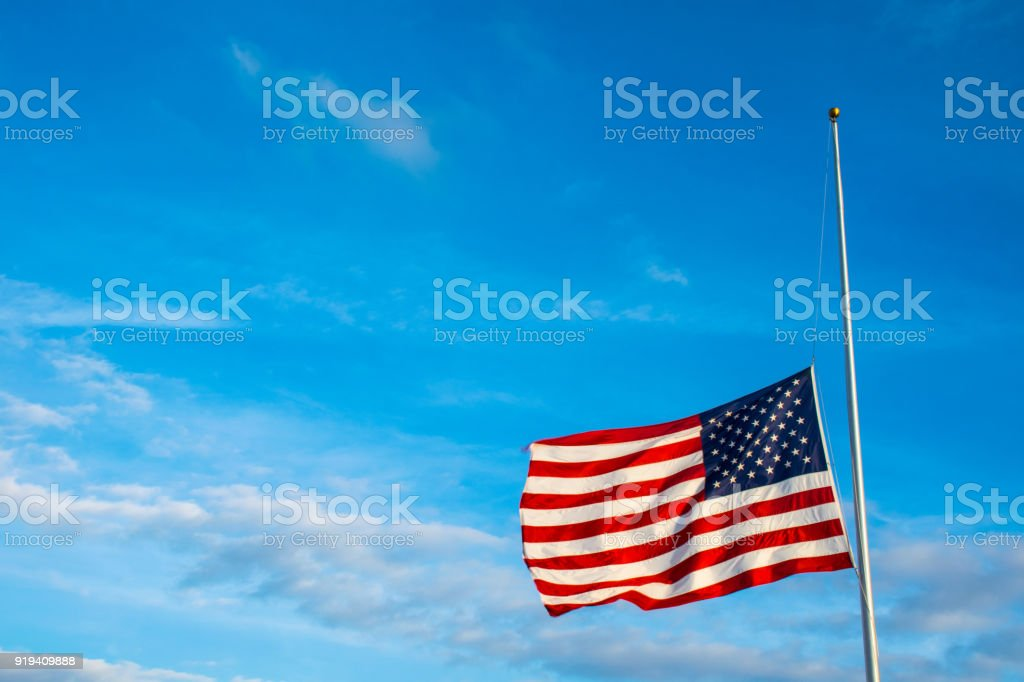 American Flag at Half Mast after another School Shooting stock photo