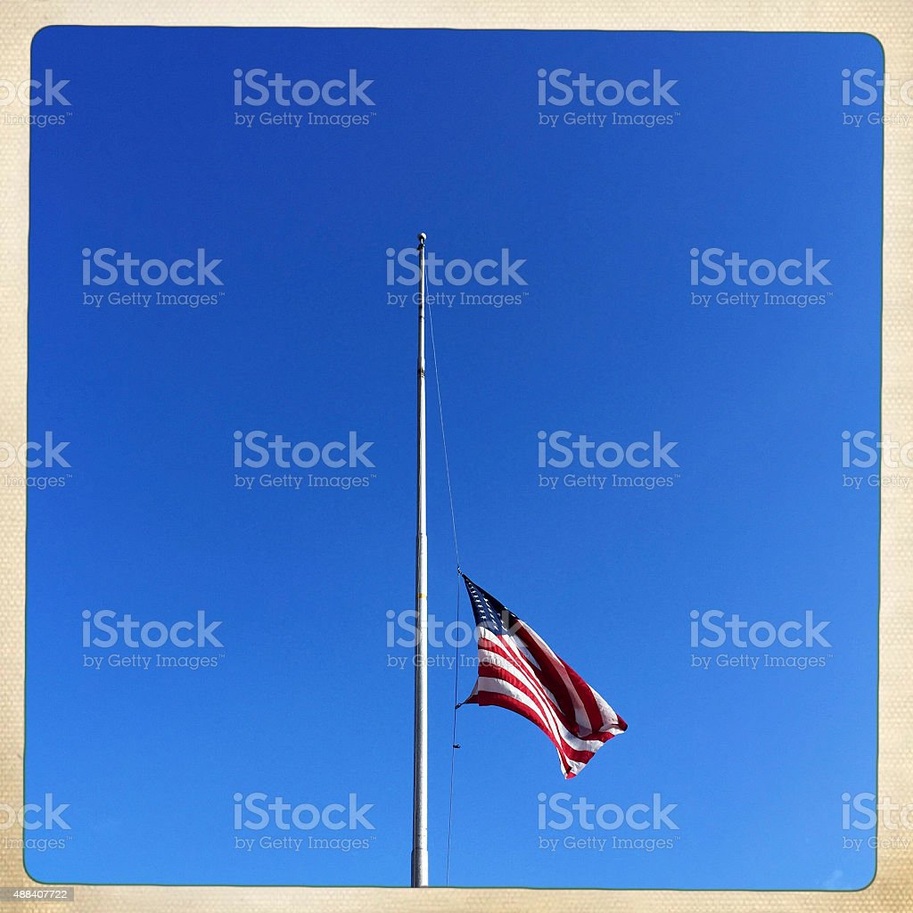 American Flag at Half Staff stock photo