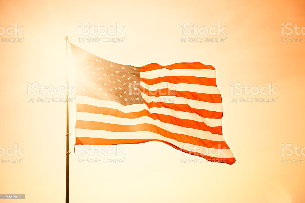 American Flag at sunset on Fourth of July stock photo