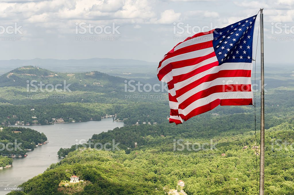 American flag at the top of Chimney Rock mountain stock photo