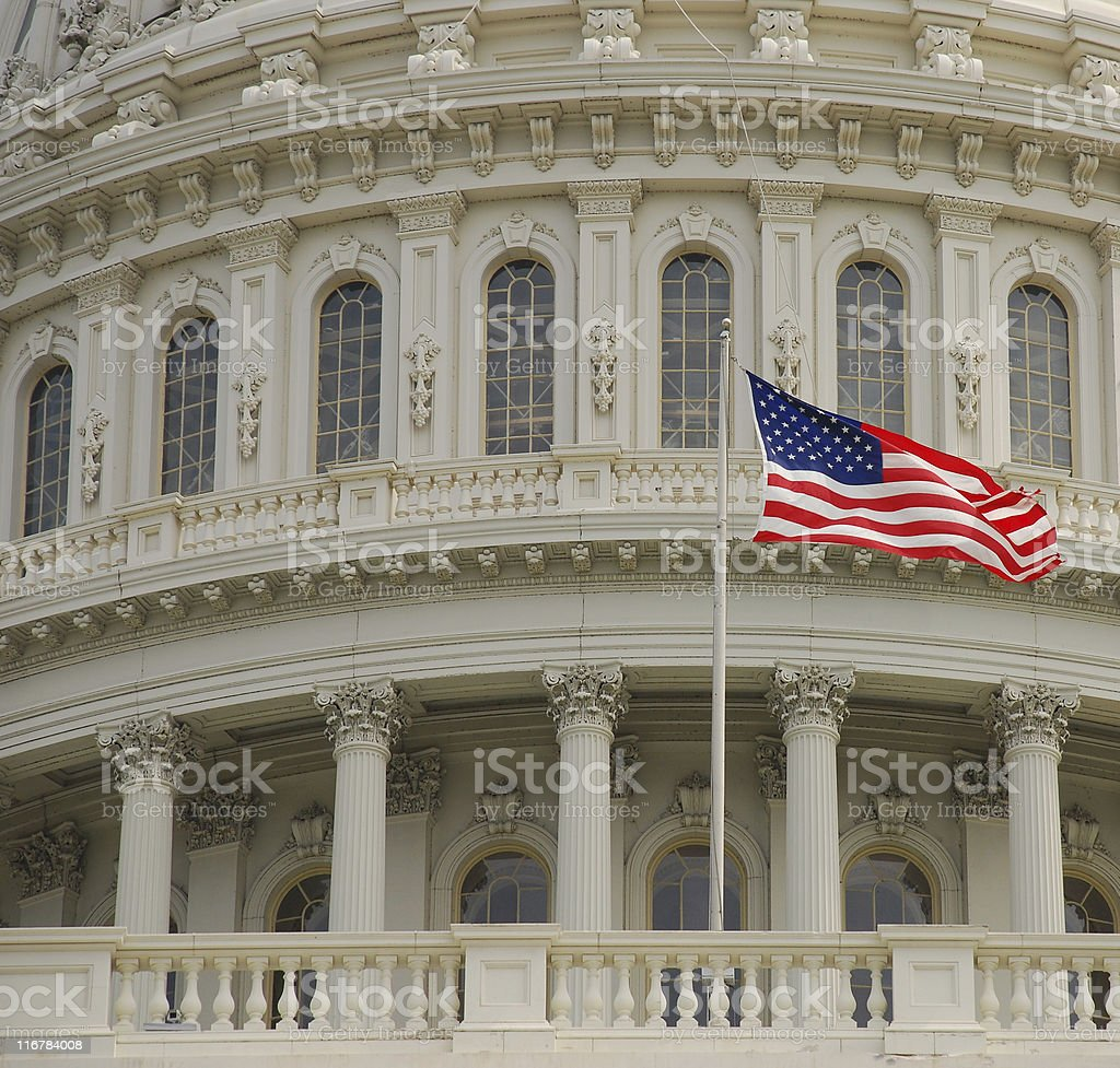 American flag at U.S. Capitol Building royalty-free stock photo