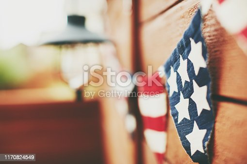 American flag background. Flag bunting hanging on fence