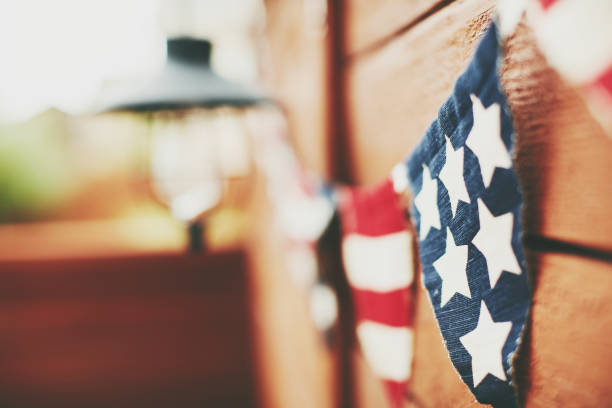 American flag background. Flag bunting hanging on fence American flag background. Flag bunting hanging on fence labor day stock pictures, royalty-free photos & images