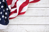 American flag on an old white wood background with textured effect
