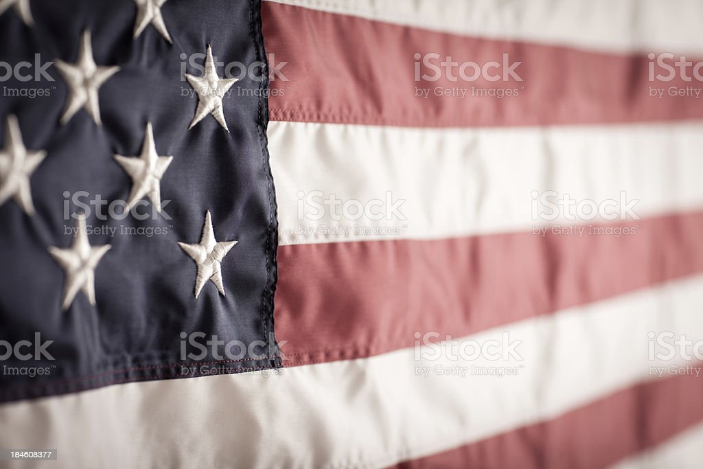 Close up color image of an American flag. Some desaturation and grain...