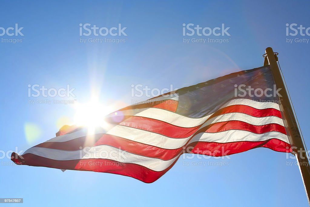 american flag backlit from the sun royalty-free stock photo