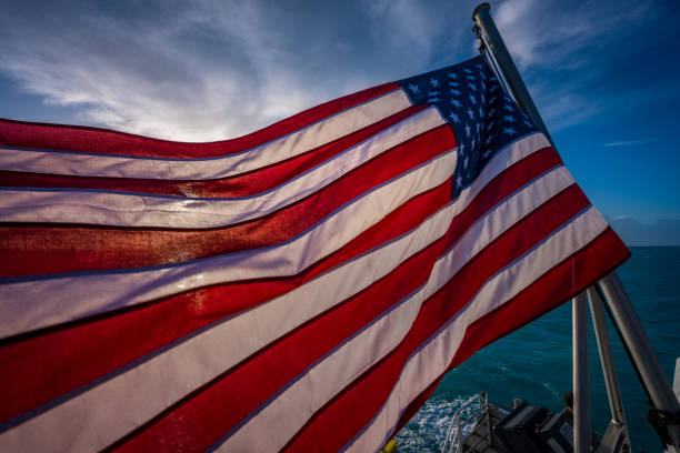 American Flag Backlit with Early Morning Sun stock photo