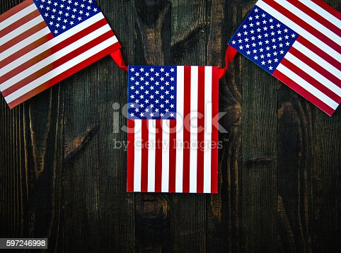 612818918 istock photo American flag banner on wood for US holidays 597246998