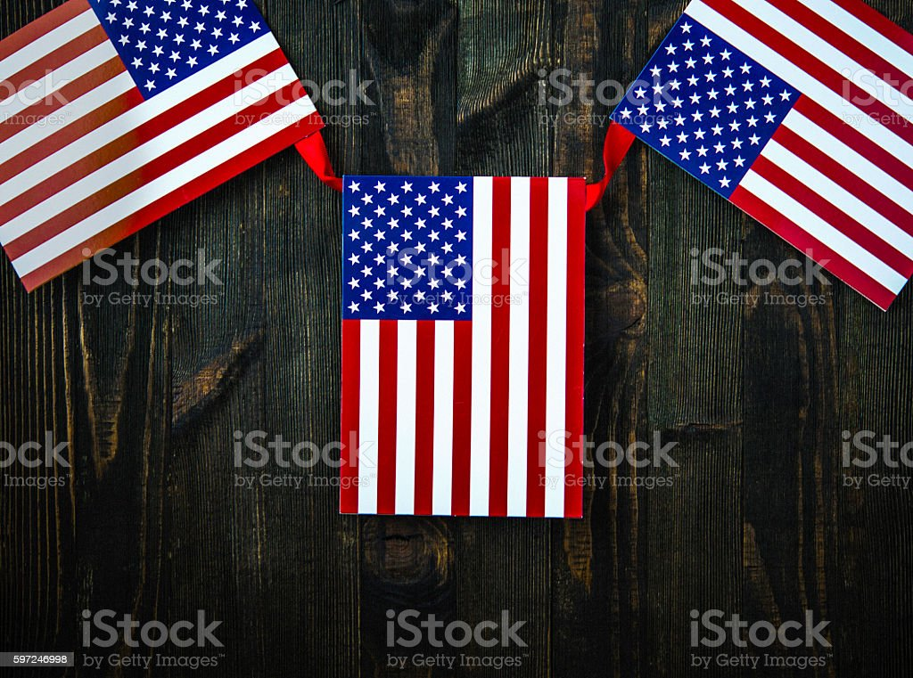 American flag banner on wood for US holidays stock photo
