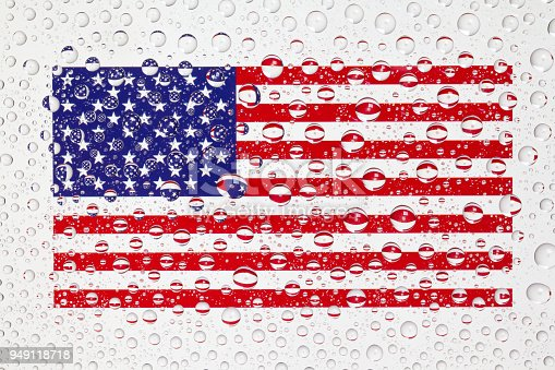 istock American flag behind a glass covered with raindrops 949118718