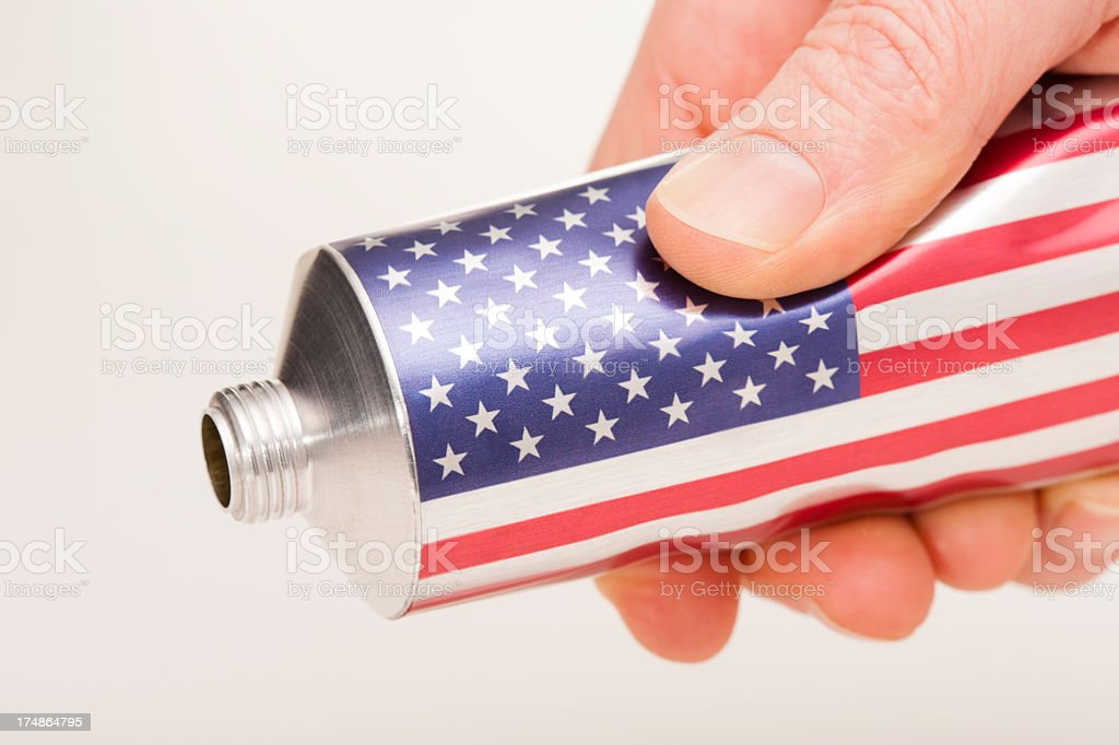 American flag being squeezed royalty-free stock photo